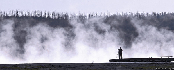 A lone photographer capturing late evening images at Grand Prismatic Spring.